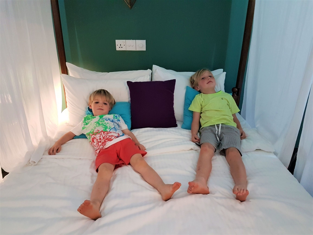 The boys getting comfortable with their new bed for the next 2 nights in Unawatuna
