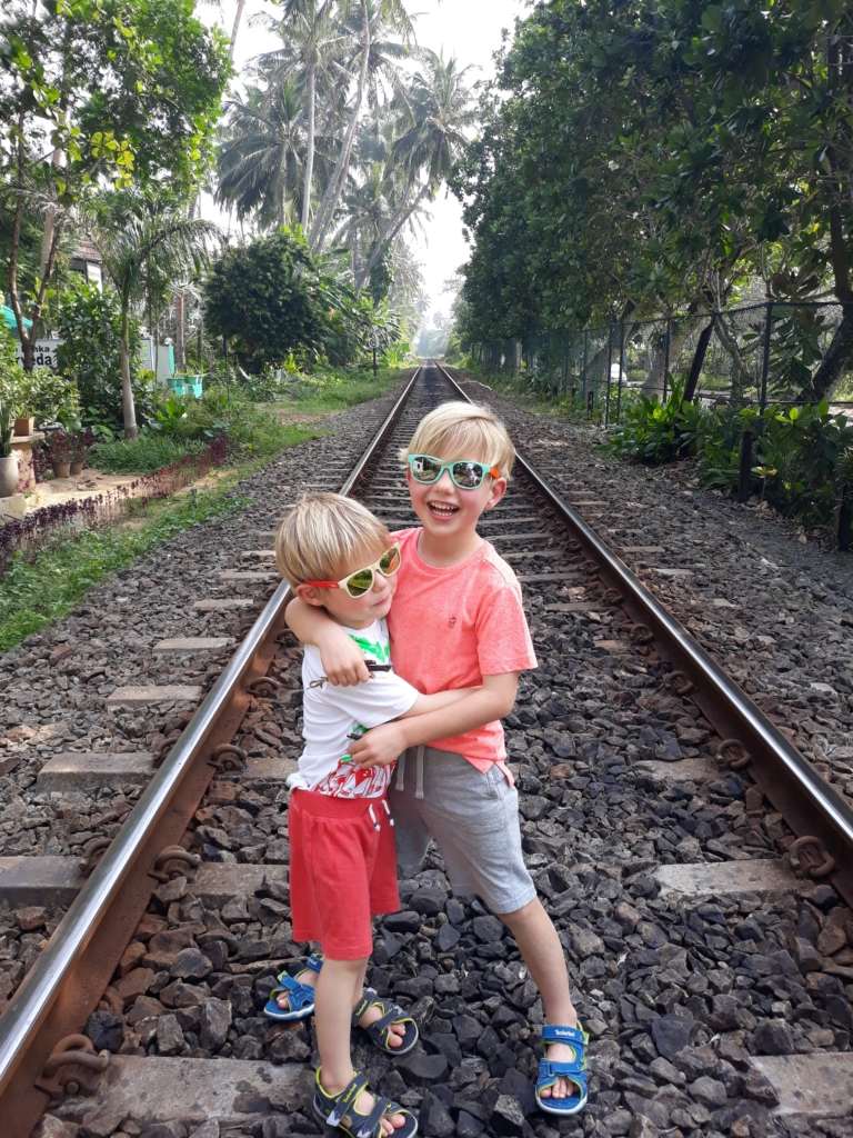 Kids crossing the railway tracks to get to the restaurant
