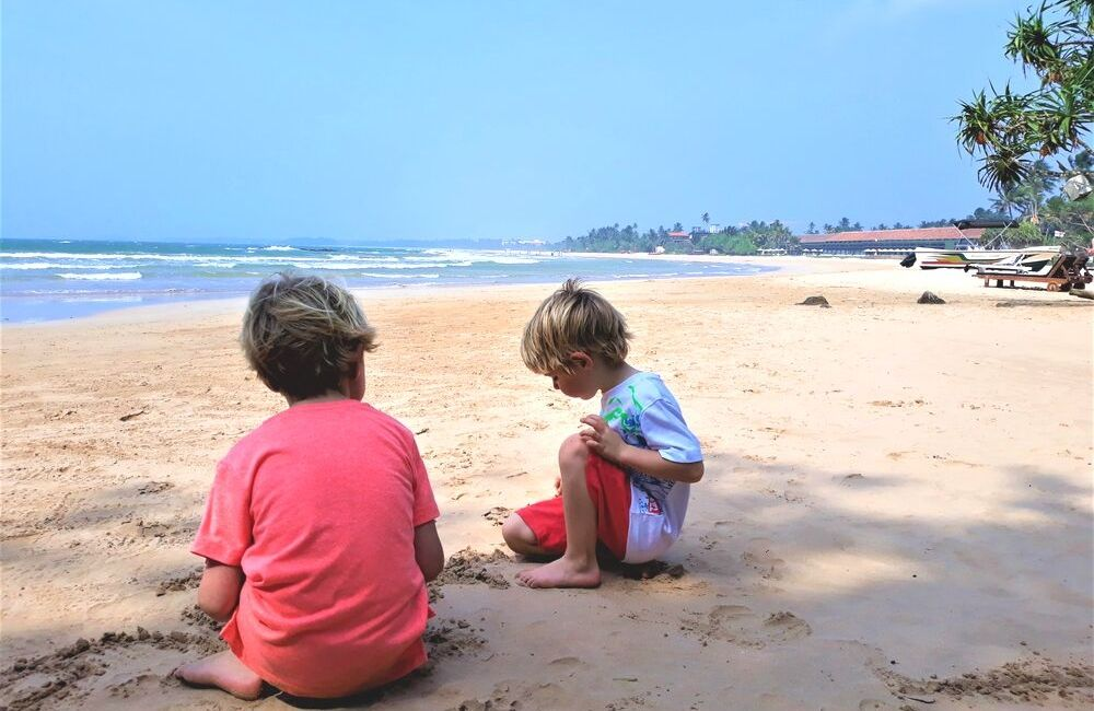 The beautiful palm fringed Bentota beach in Sri Lanka