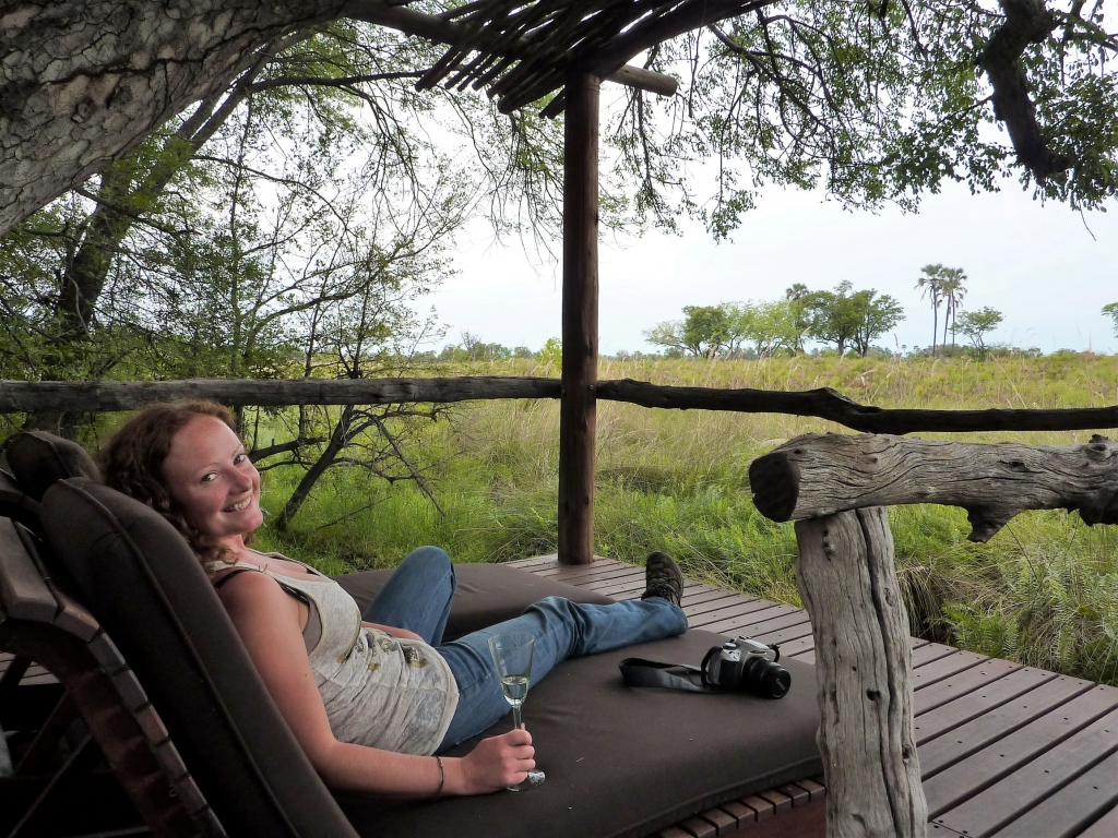 Chilling on our veranda reviewing the photos on our Canon EOS400D after an early morning safari