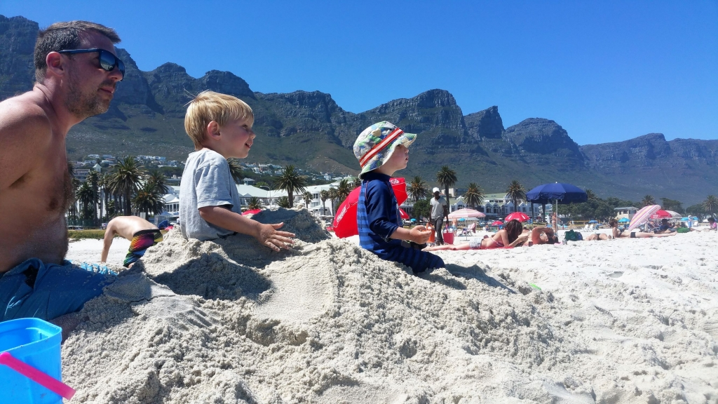 Beautiful white sandy beaches of Cape Town with the dramatic Twelve Apostles in the background
