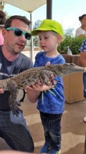 Holding a baby crocodile in Oudtshoorn