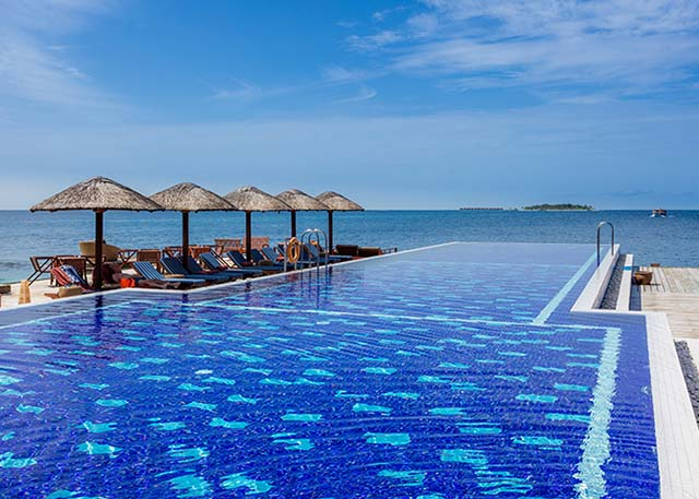 The main infinity pool at the Centara Grand Maldives