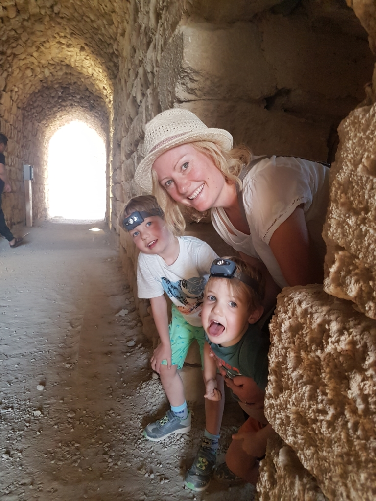Visiting Jordan with kids: exploring the dark rooms in Kerak Castle
