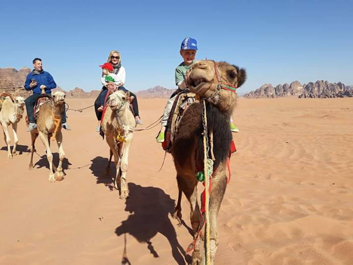 Camel riding in Wadi Rum with kids