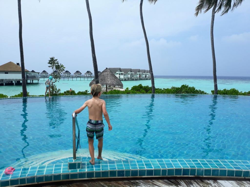 The pool area at The Club - Centara Grand Maldives