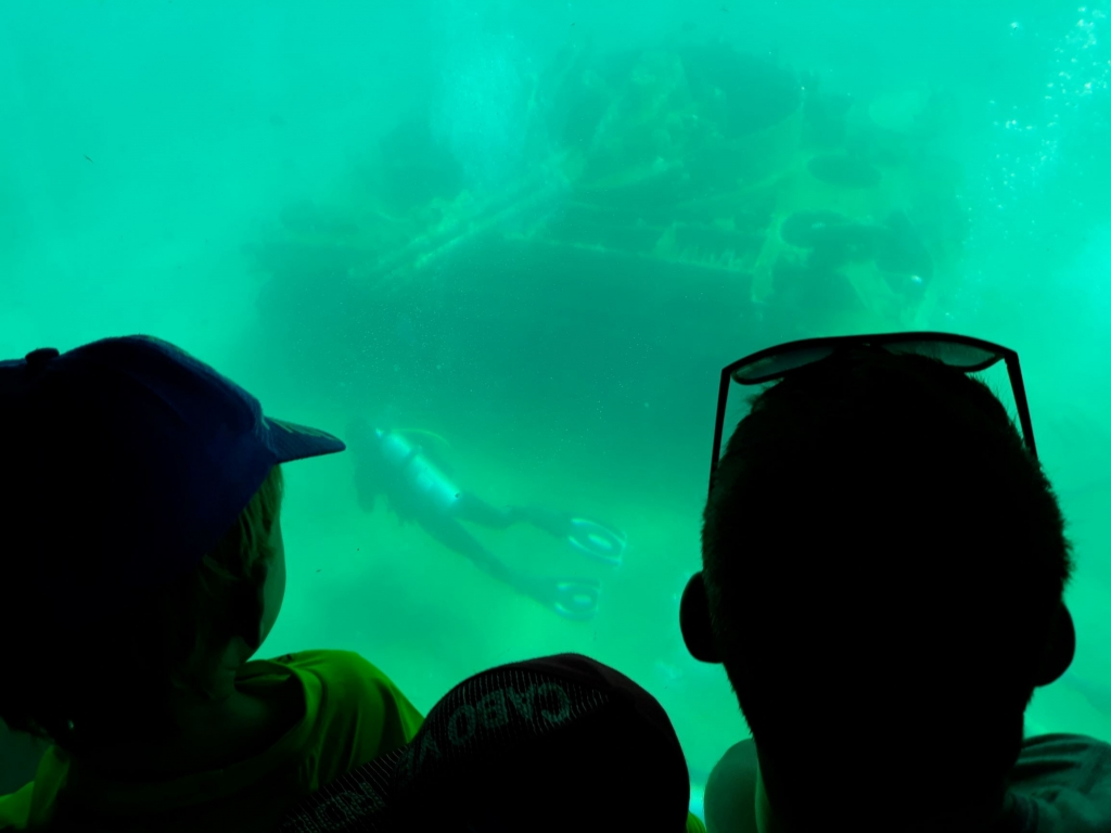 Watching divers at the red sea tank wreck from our submarine