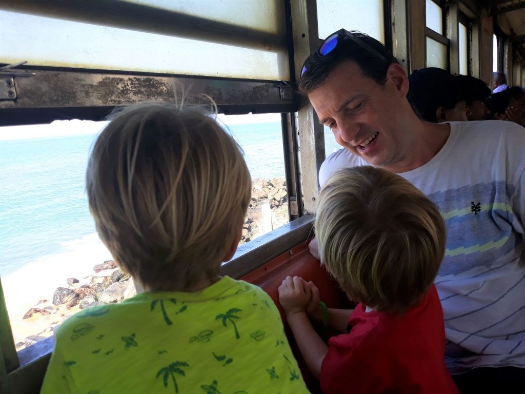 The boys enjoying the sea views from the train ride into Colombo Fort from Wellawatte