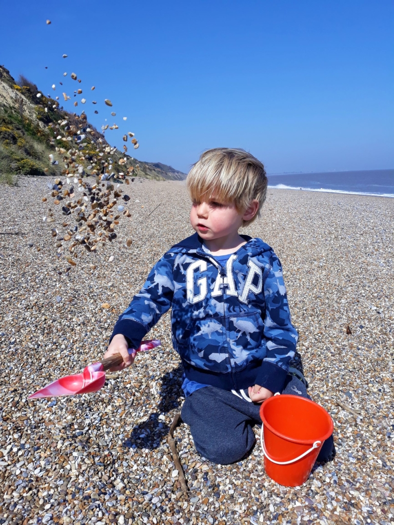 Sorting out the many stones collected on the beach walks at Dunwich