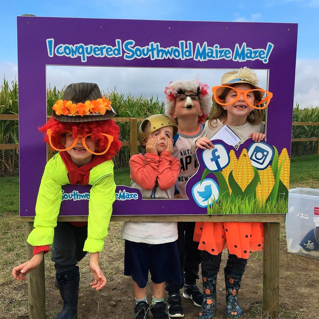 The kids messing around with the dressing up box at Southwold Maize Maze