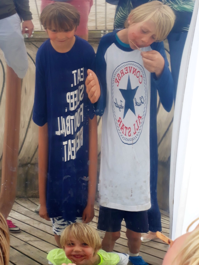 Ice cream faces distorted by the wacky mirrors on Southwold Pier