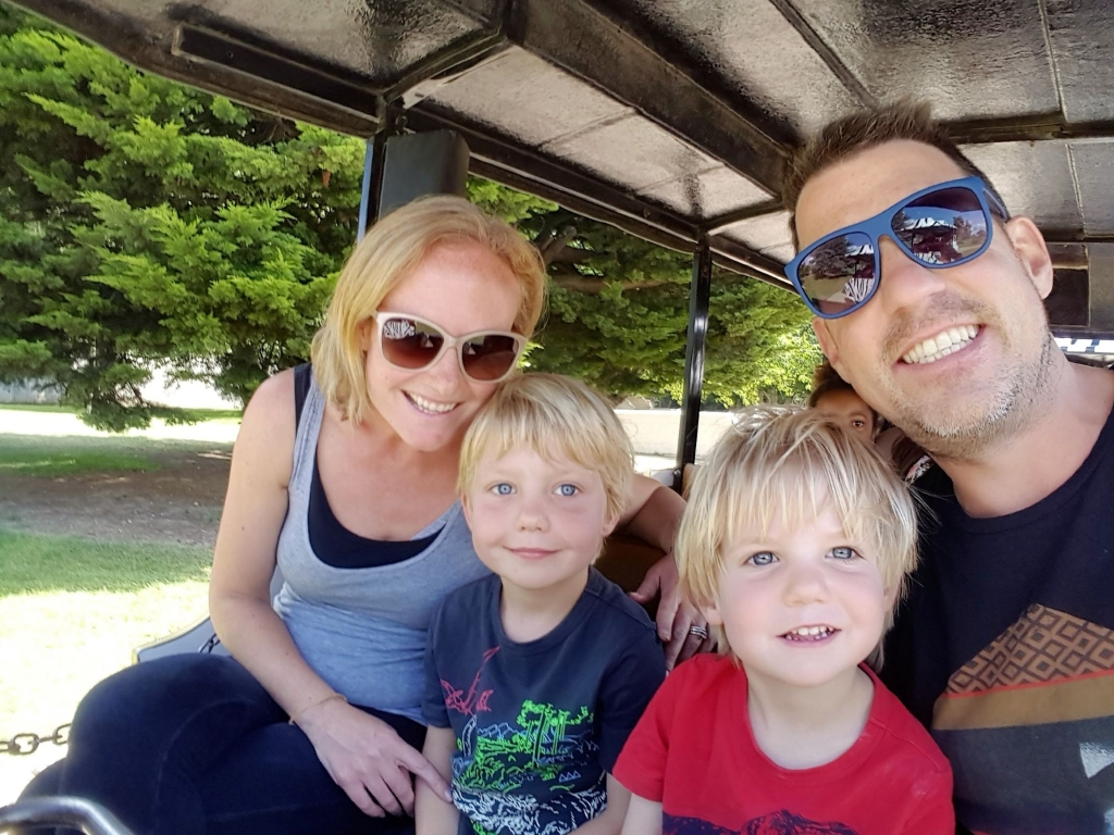 Enjoying a break from walking by taking the safari road train at Africa Alive