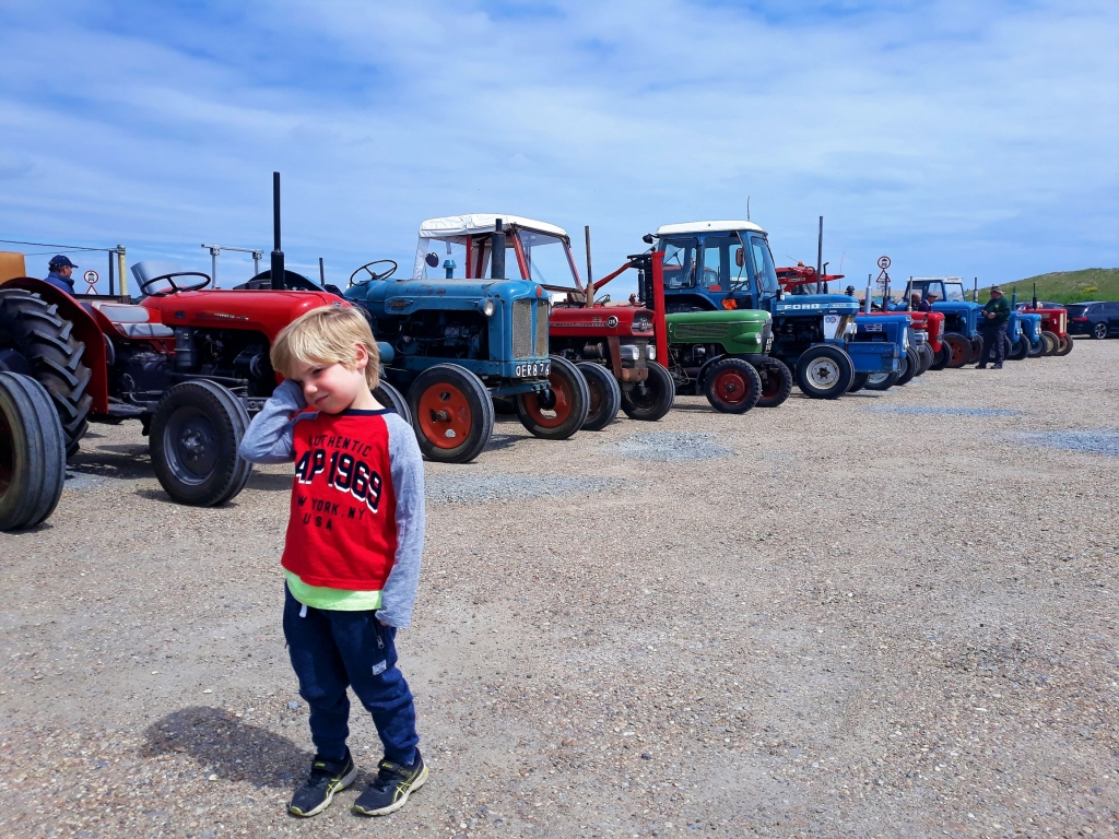 Gathering of Suffolk farmers and their old tractors at Dunwich beach