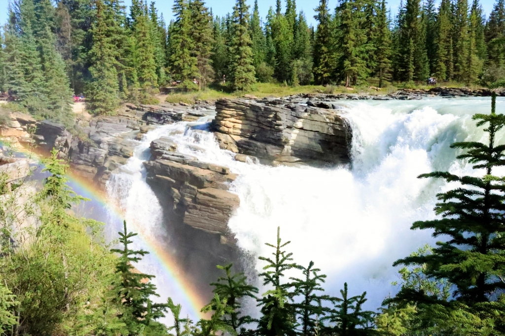 The mighty Athabasca Falls in Jasper National Park with a delicate rainbow