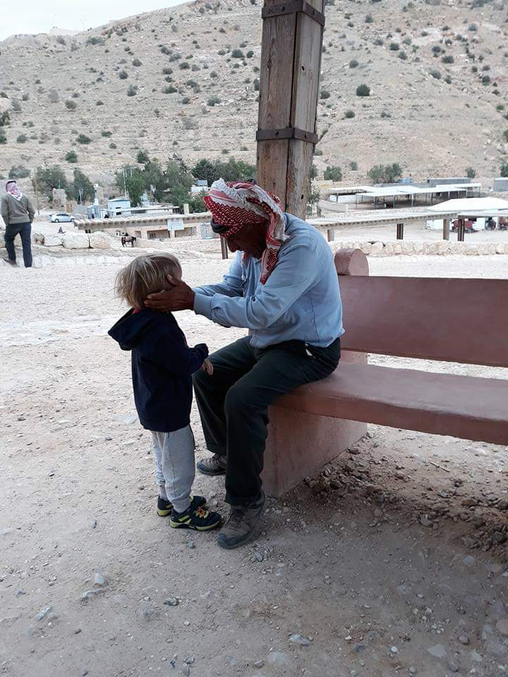 Visiting Jordan with kids: talking to a pony owner