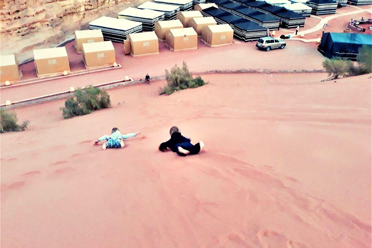 Sand dune surfing at Rahayeb Desert Camp Wadi Rum