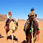 Visiting Jordan with kids: camel riding in Wadi Rum