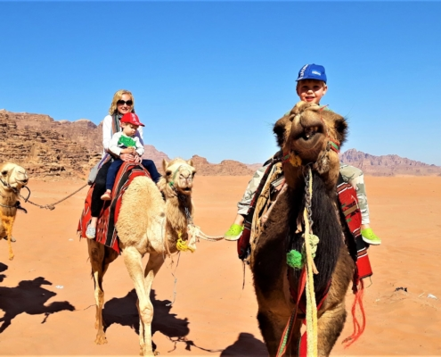 Visiting Jordan with kids: camel riding in Wadi Rum
