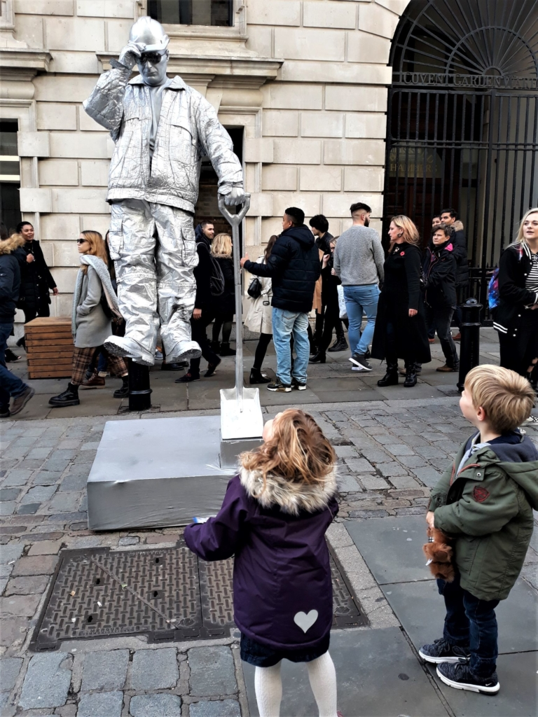 Best things to do in London with kids - watching street performers in covent Garden