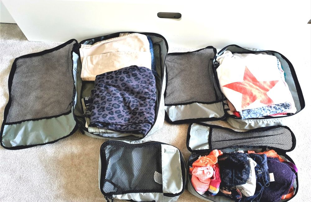 Fill your packing cubes with clothes