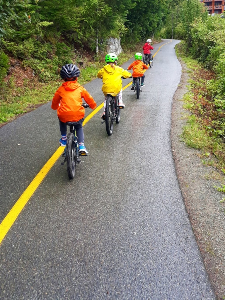 Kids cycling along the Whistler Valley Trail cycle path