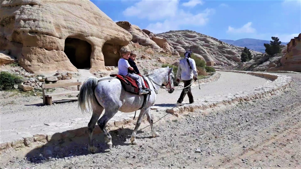Visiting Petra with kids on a pony along the Siq