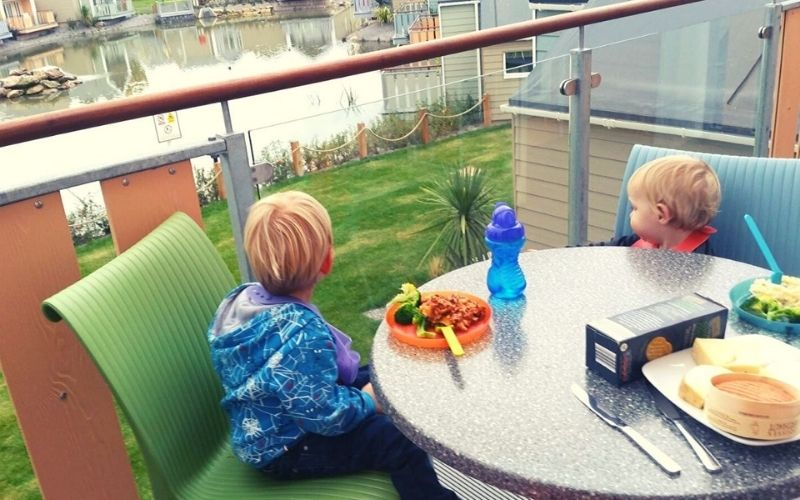 Dining on the balcony at the West Lake Chalets at Butlins Minehead.