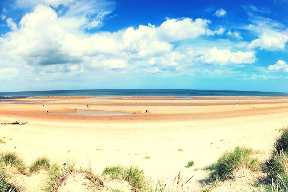 Wide stretch of sand at Holkham Beach - one of the best Norfolk beaches for dog walking