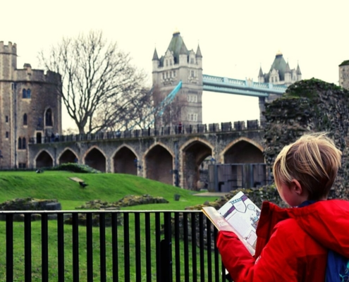 Studying the guidebook at the Tower of London