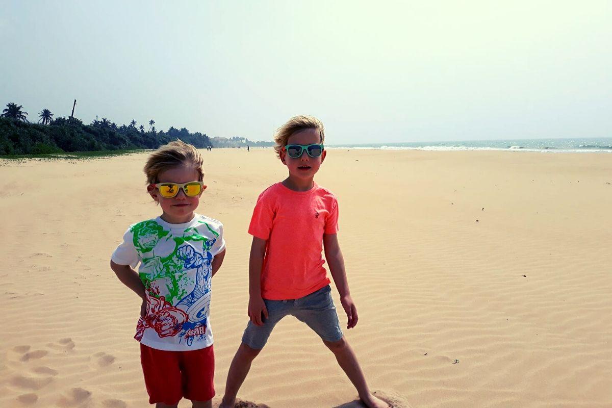 Kids enjoying the long stretch of sand at Bentota Beach