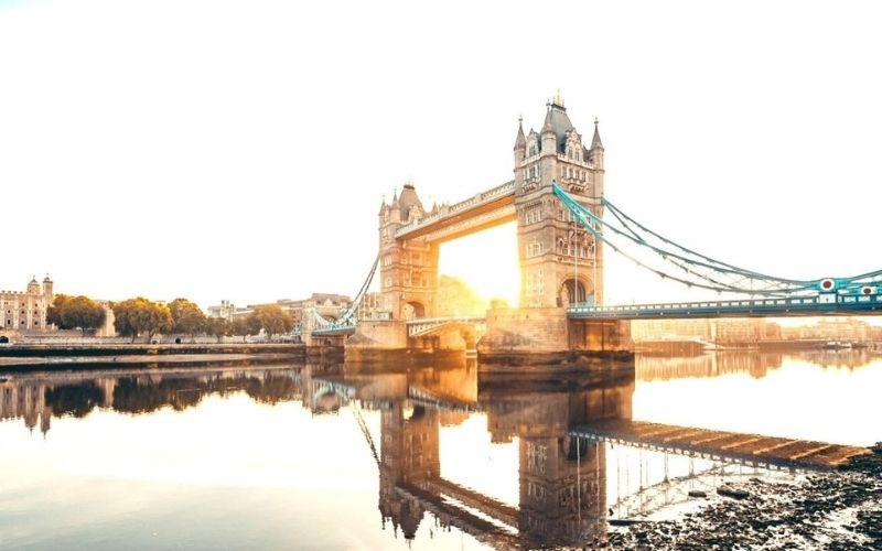 Tower Bridge in London at sunrise.