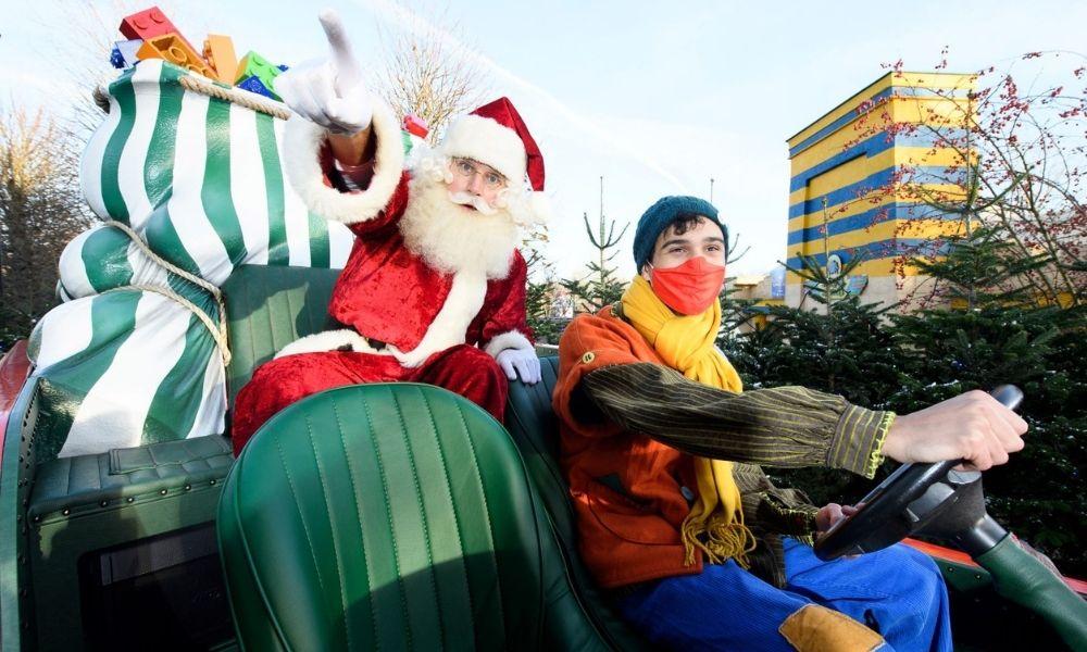 Santa on a sleigh waving