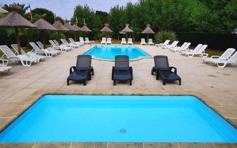 Pool area at Camping Les 4 Chênes