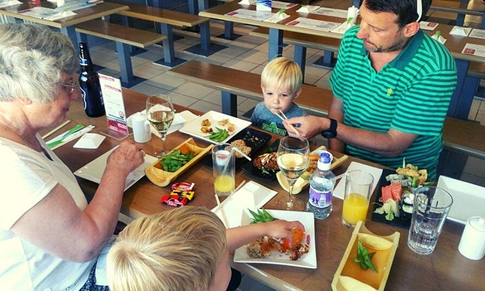 Kids eating Japanese food