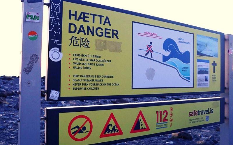 Warning sign at Reynisfjara (Black Sand Beach)
