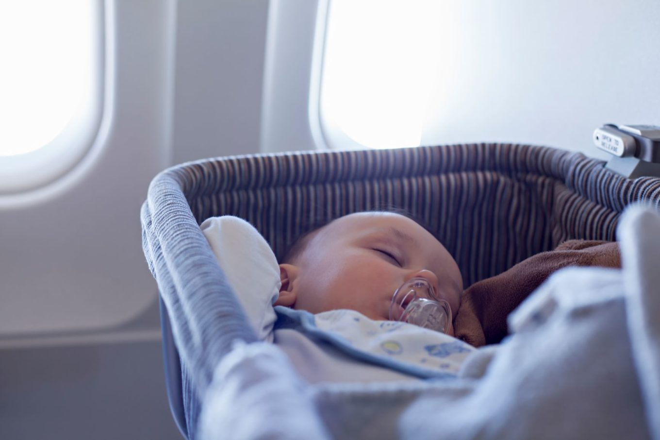 Baby in a bassinet on a plane