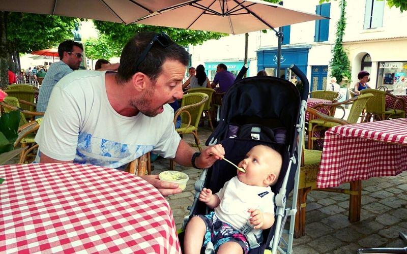 Feeding baby in a stroller