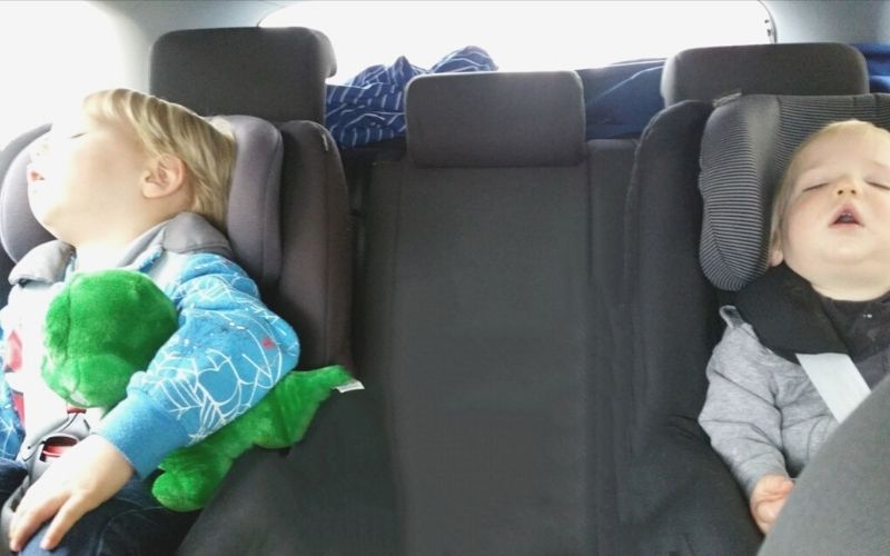 Kids sleeping on a road trip