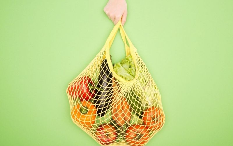 String bag with loose fruit and vegetables