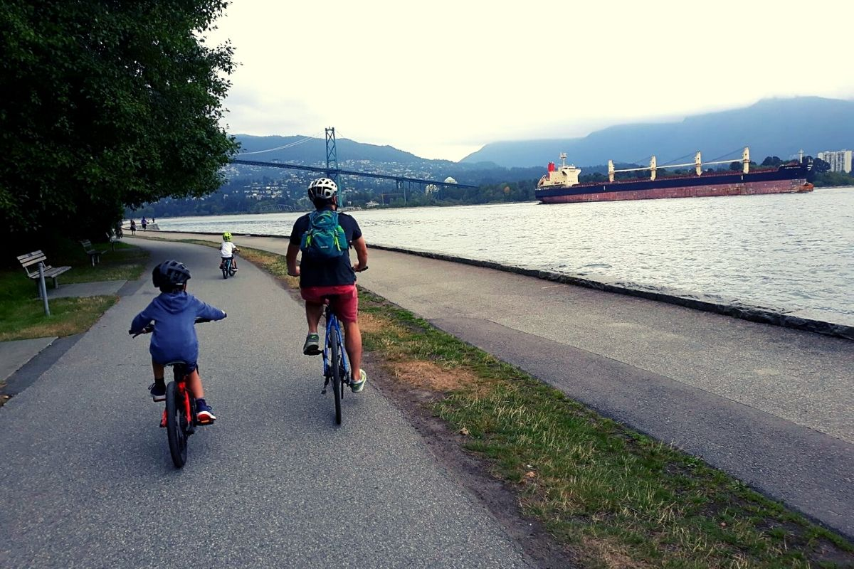 Cycling around the Vancouver Seawall in Stanley Park.