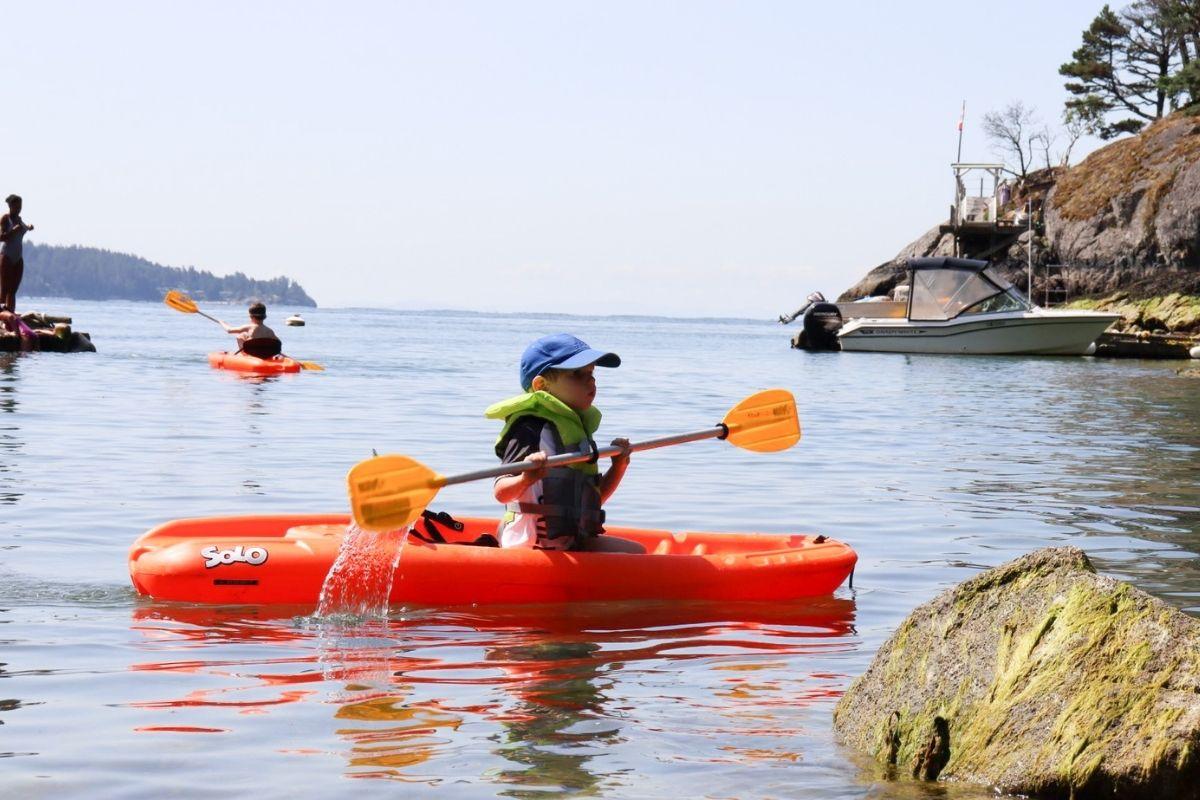 Kids kayaking on Bowen Island.