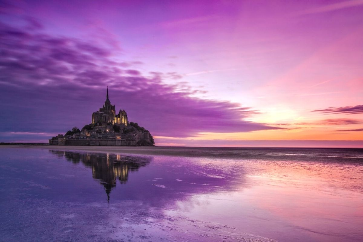 Le Mont-Saint-Michel in Normandy at sunset.