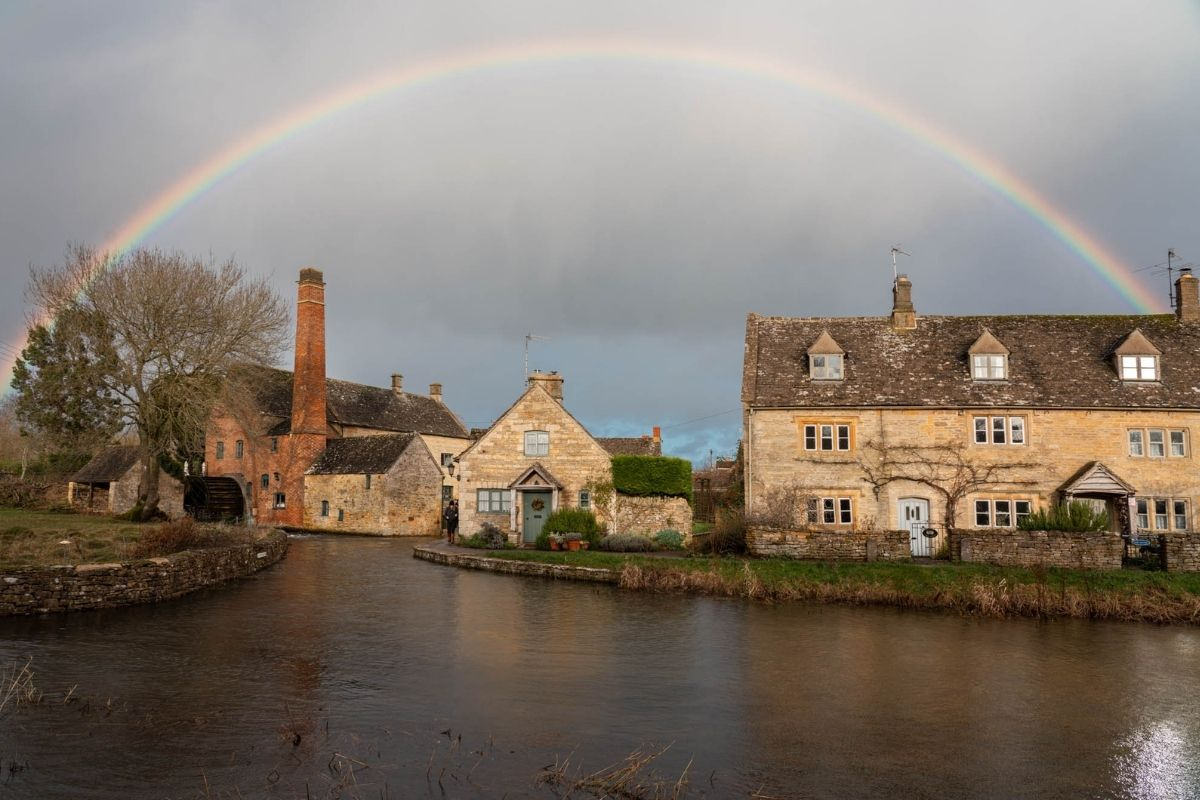 Rainbow over Lower Slaughter Cotswolds - We Dream of Travel
