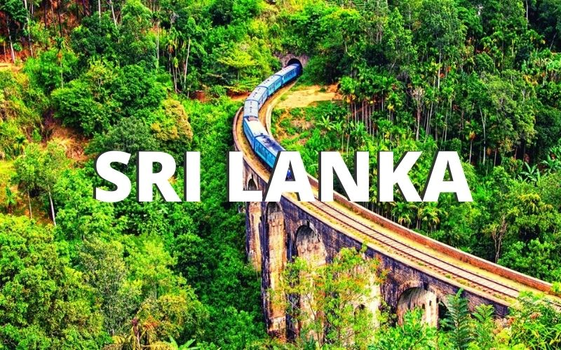 Train crossing Nine Arch Bridge in Ella Sri Lanka.