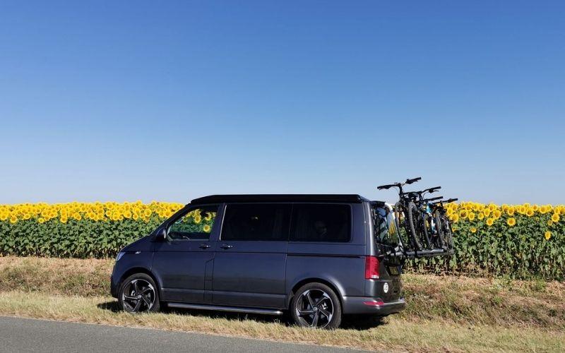 Bikes on the back of a VW campervan.