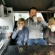Drinking hot chocolate in a campervan.