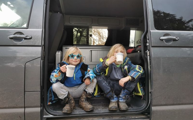 Enjoying a well deserved hot chocolate in the campervan with kids after a long winter walk.