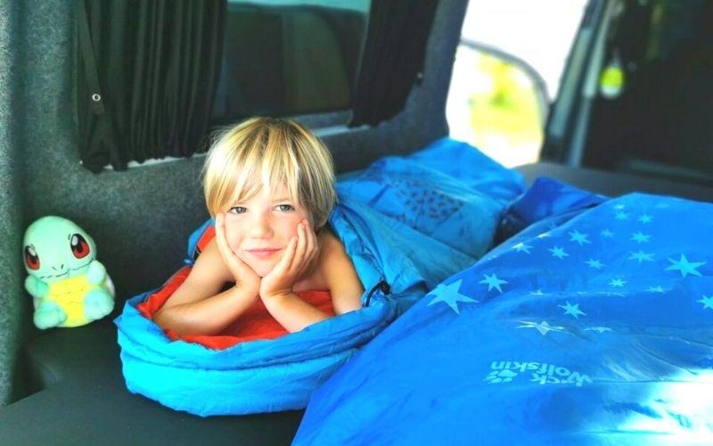 Jack Wolfskin toddler sleeping bag with little boy in.