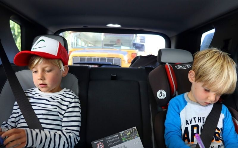 Playing travel games for kids on a car journey.
