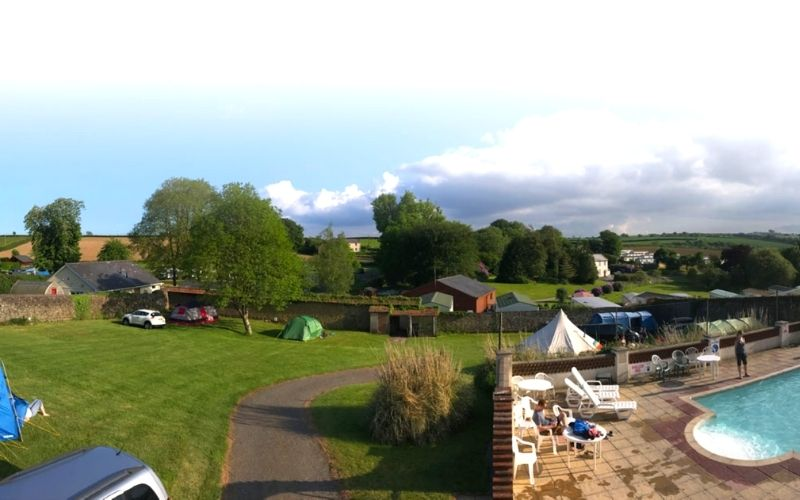 Pool and camping pitches at Smytham Holiday Park.